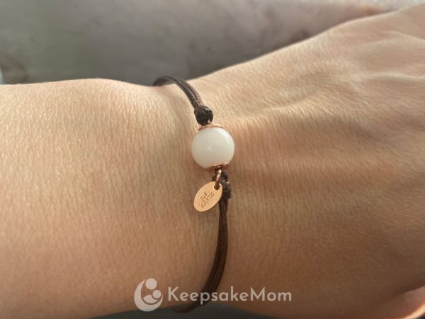 breastmilk-bracelet-pearl-cord-modeled